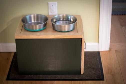 Custom dog feeding station with food storage.